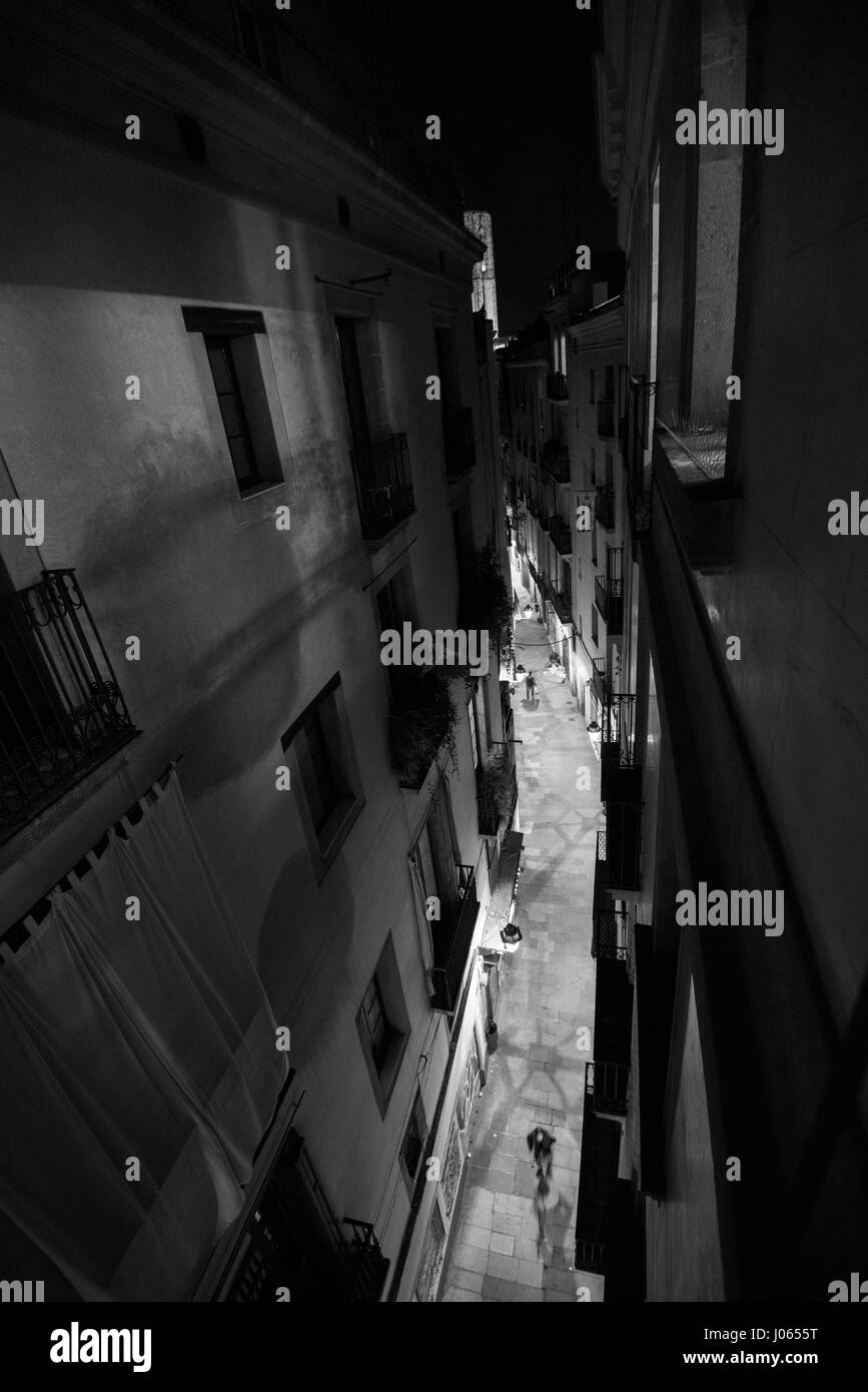 Looking down to an alleyway off La Rambla in the Gothic Quarter of Barcelona, Spain Europe EU - Stock Image