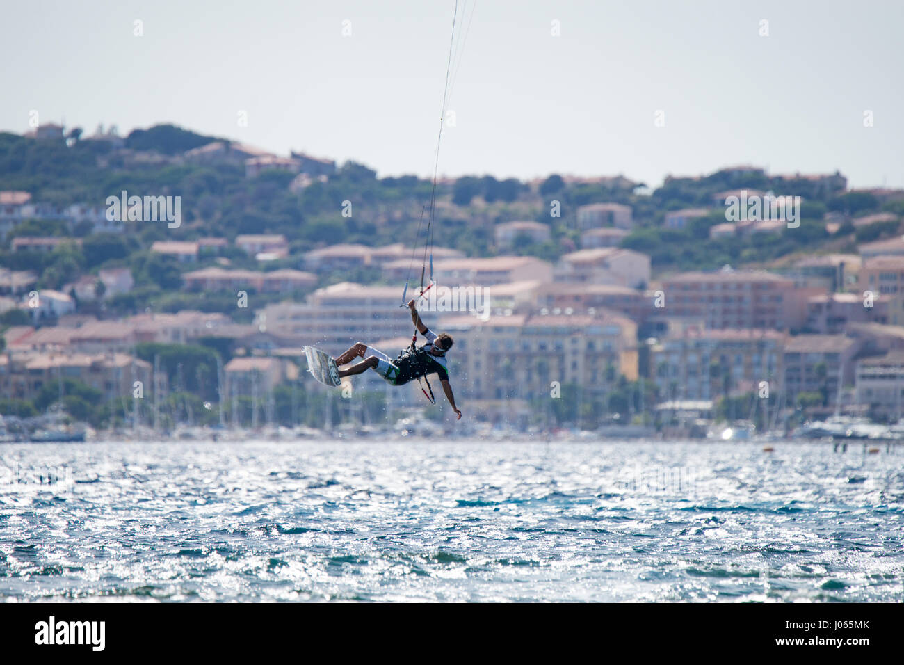 A kitesurfer in Calvi, Corsica. Corsica is the most mountainous Mediterranean island and is located in the west - Stock Image