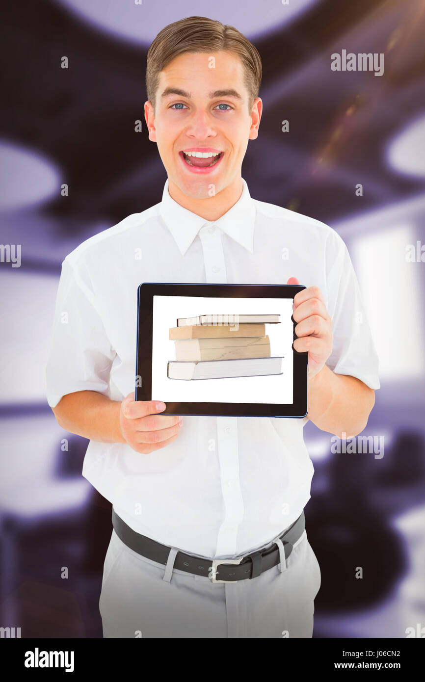 Geeky businessman showing his tablet pc against classroom - Stock Image