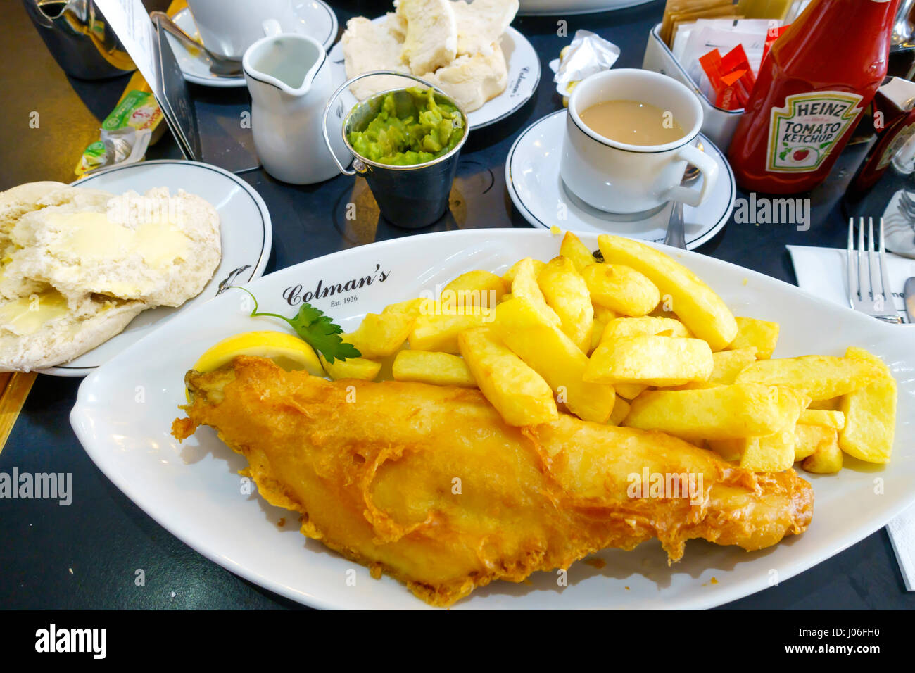 Excellent fish and chips at Colman's famous fish restaurant in South Shields founded in 1926, with a bread roll - Stock Image