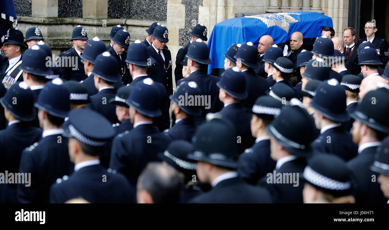 Pall bearers carry the coffin of PC Keith Palmer out of Southwark Cathedral in London after his funeral service. - Stock Image