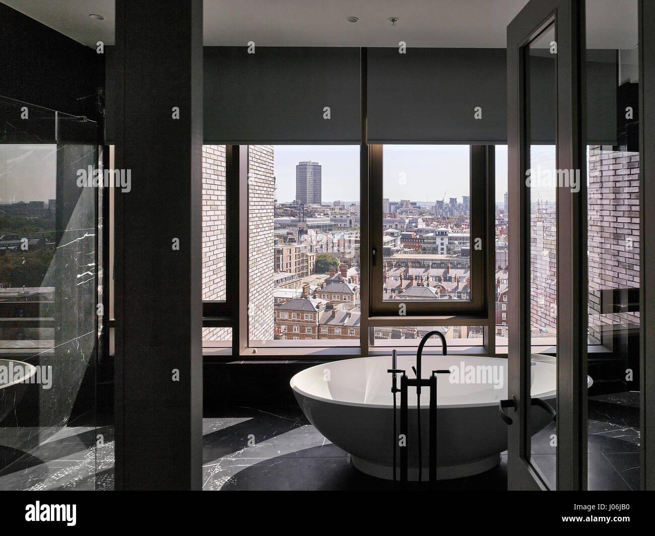 Bathroom and cityscape. 55 Victoria Street, London, United Kingdom. Architect: Stiff + Trevillion Architects, 2016. - Stock Image