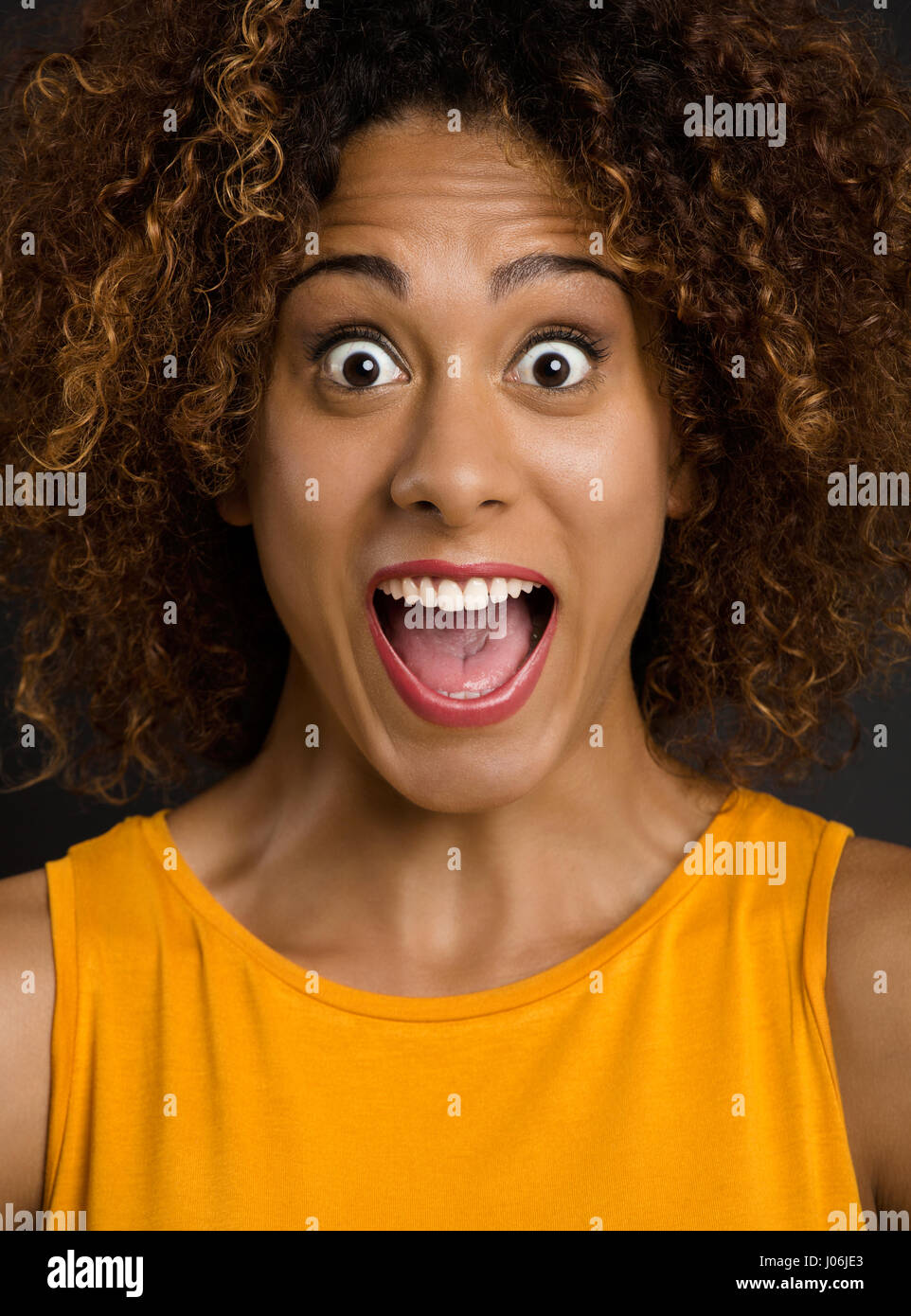 Portrait of a beautiful African American woman after receiving good news - Stock Image
