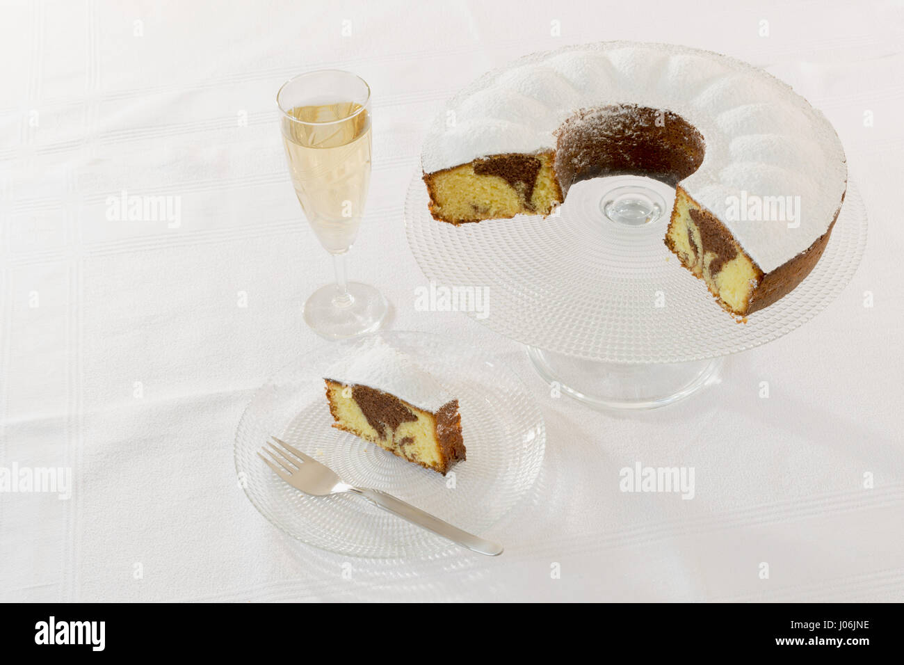 bicolor donut on glass lifted from above Stock Photo