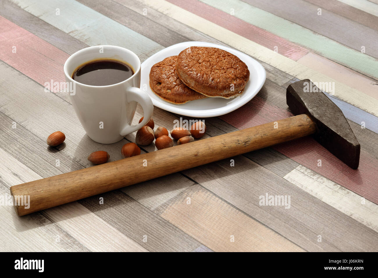 Coffee break with hammer - Stock Image