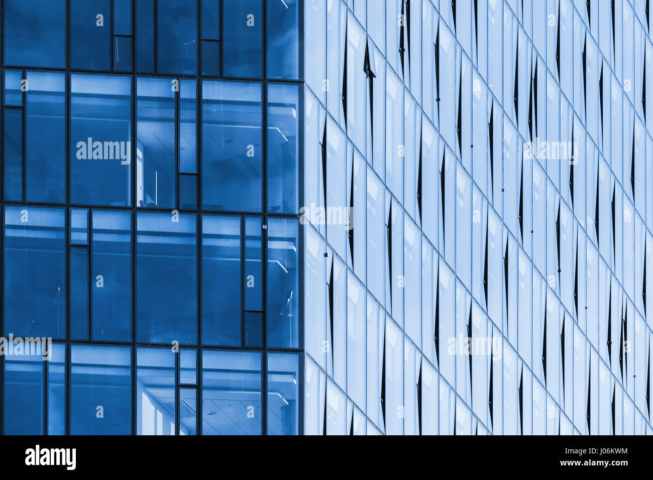 Modern office building corner, blue glass and steel frames Stock ...