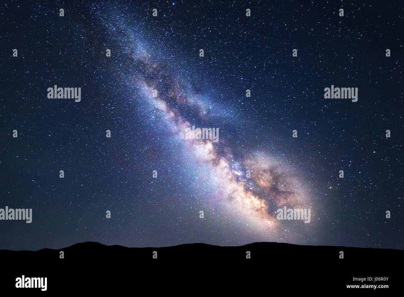 Milky Way. Colorful night landscape with bright milky way, starry sky and hills in summer. Space background. Amazing - Stock Image