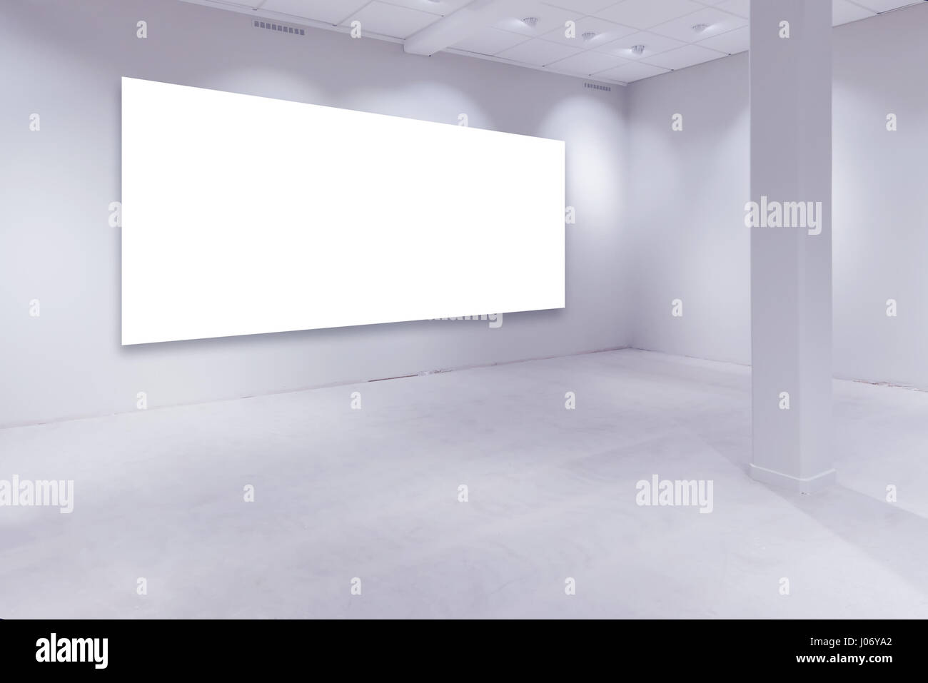 Spot lights and empty white copy space on art gallery wall for painting or photograph - Stock Image