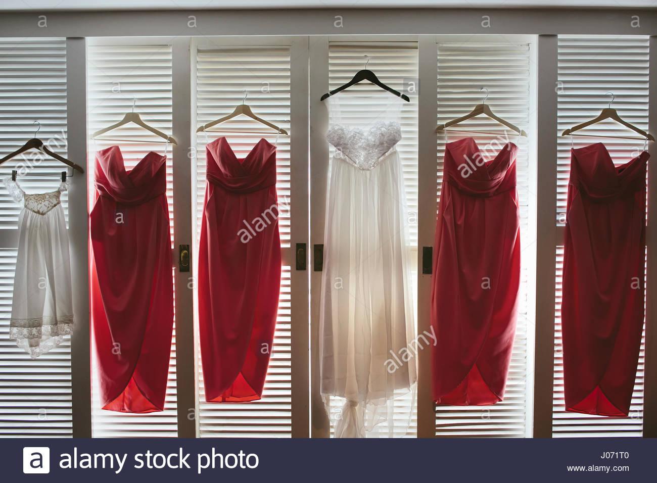 A wedding dress and bridesmaids\u0027 dresses hanging on cupboard doors Stock Photo 137838064 - Alamy & A wedding dress and bridesmaids\u0027 dresses hanging on cupboard doors ...