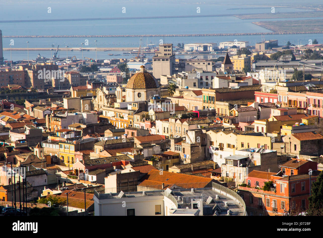 The capital city of Cagliari gleams in the Sardinian sun, once inspiring D.H. Lawrence to call it the 'white - Stock Image