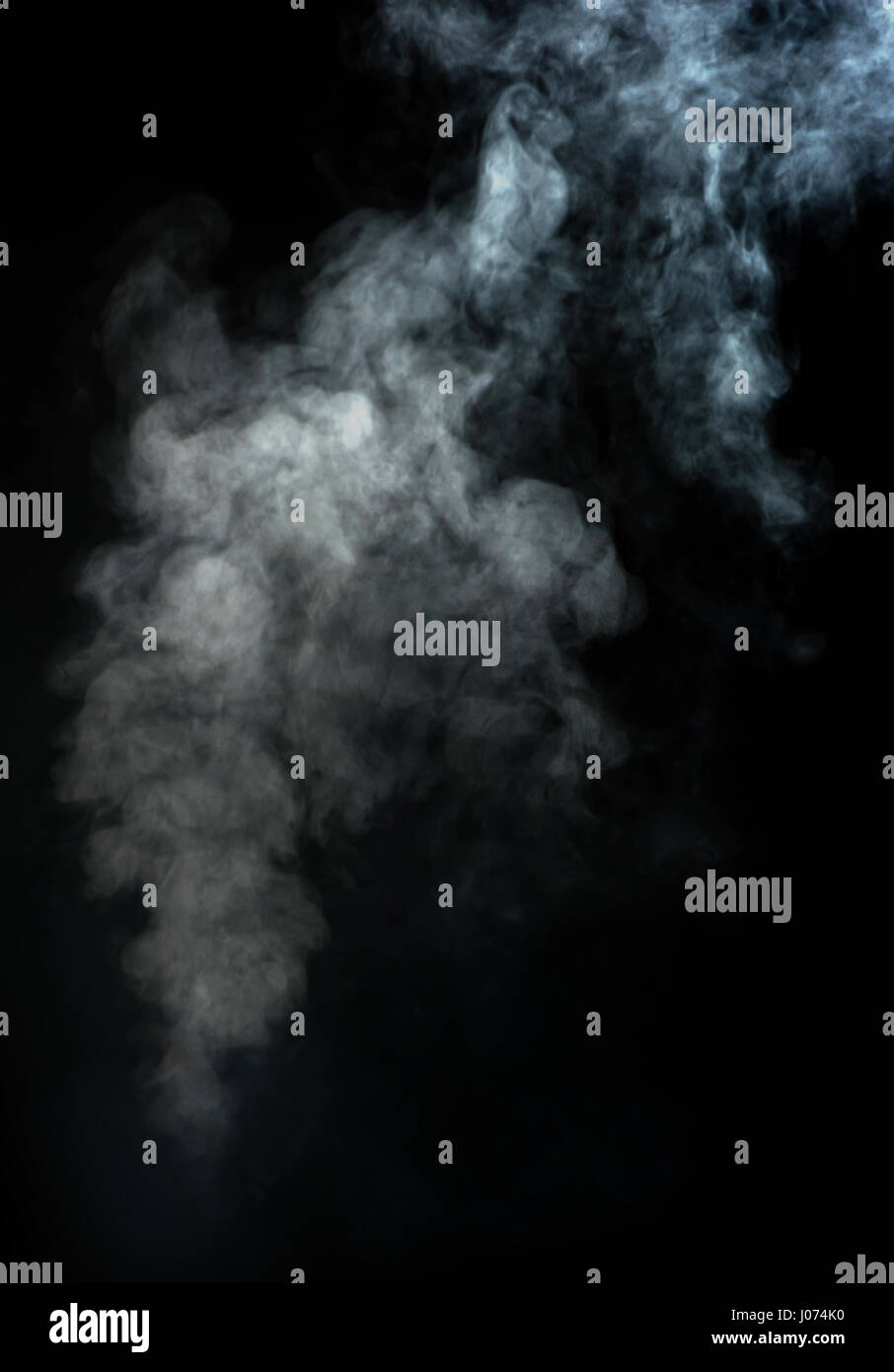 Abstract white smoke on black background - Stock Image