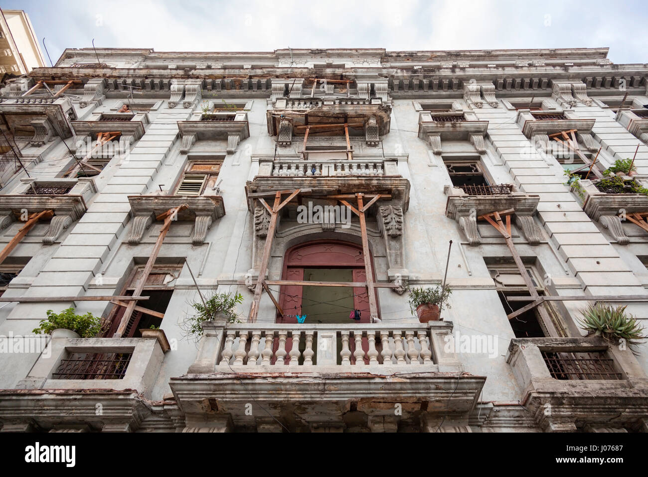 Balconies being stabilized by wooden joists on a decrepit apartment building in Old Havana, Cuba. - Stock Image