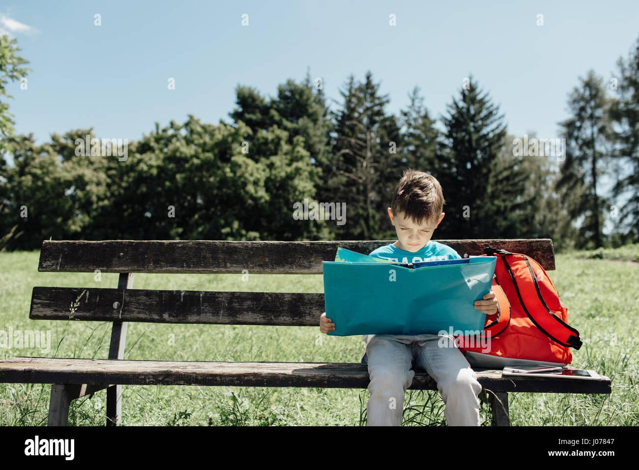 BOY SITTING ALONE ON BENCH