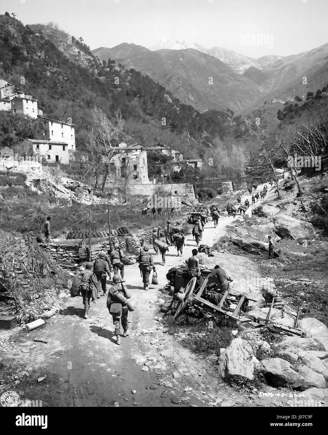 """""""African American`doughfoots' of the 92nd Infantry (`Buffalo') Division pursue the retreating Germans through the Stock Photo"""