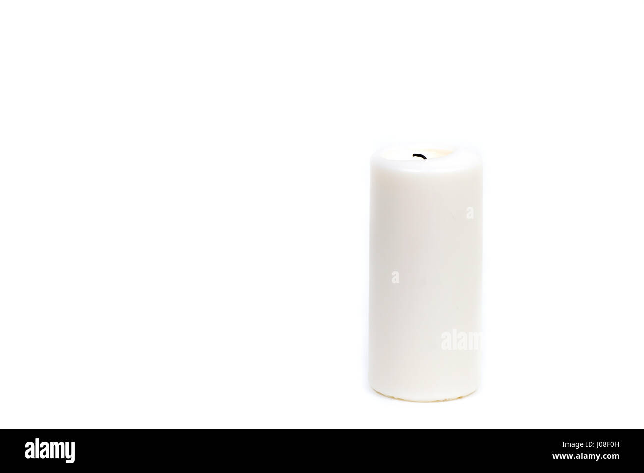 a candle is lit in the darkness and gives spiritual warmth - Stock Image