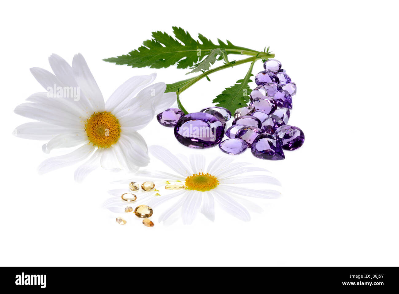 Crystal Therapy with precious stones and white background. Amethyst and yellow topaz. - Stock Image
