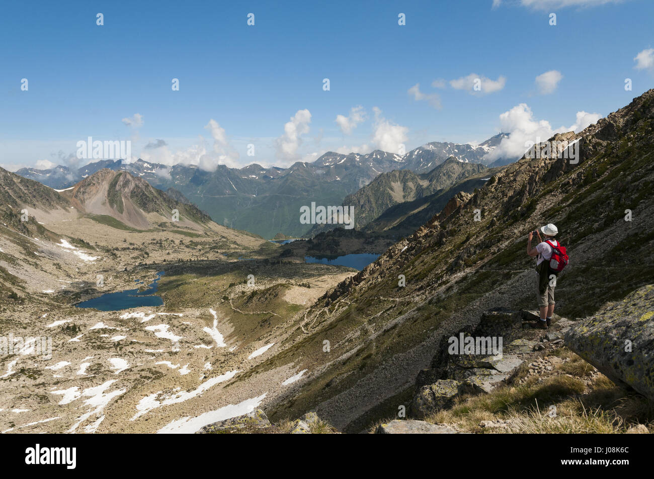 France, Pyrenees, Neouvielle Natural Reserve, landscape with hiker - Stock Image