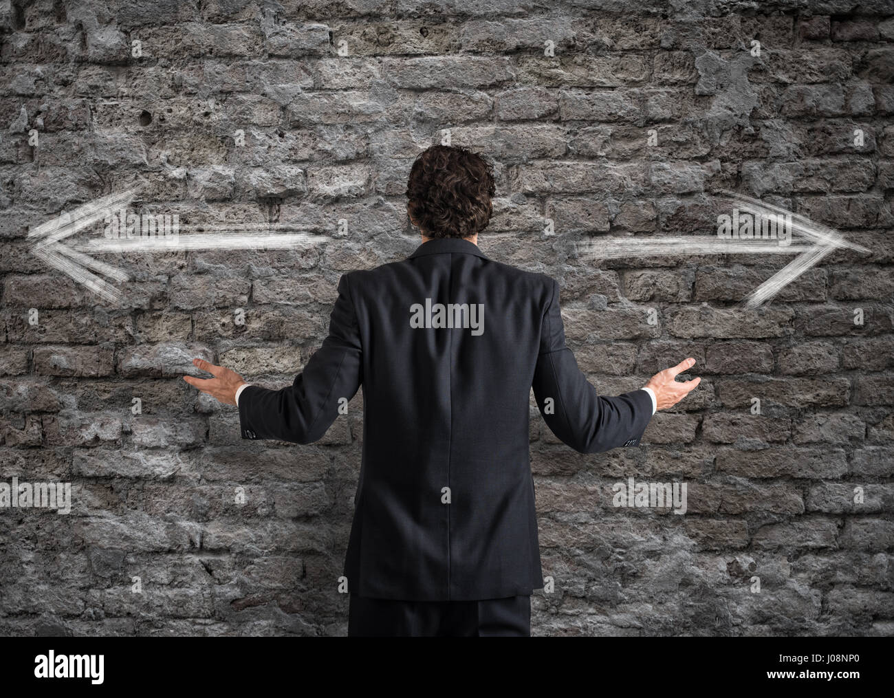 Businessman in front of a choice - Stock Image