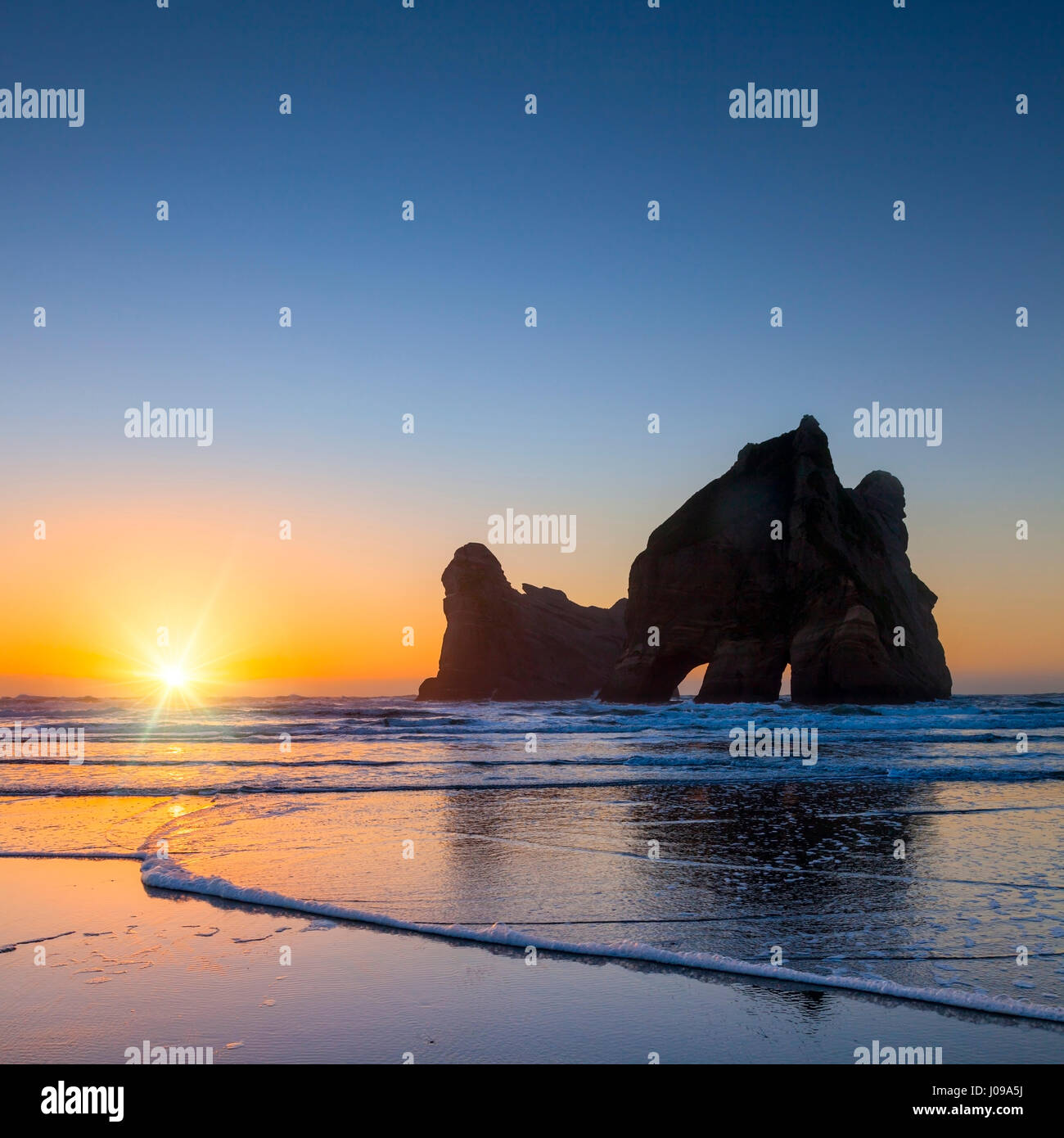 Wharariki Beach and Archway Islands, Tasman, New Zealand. - Stock Image