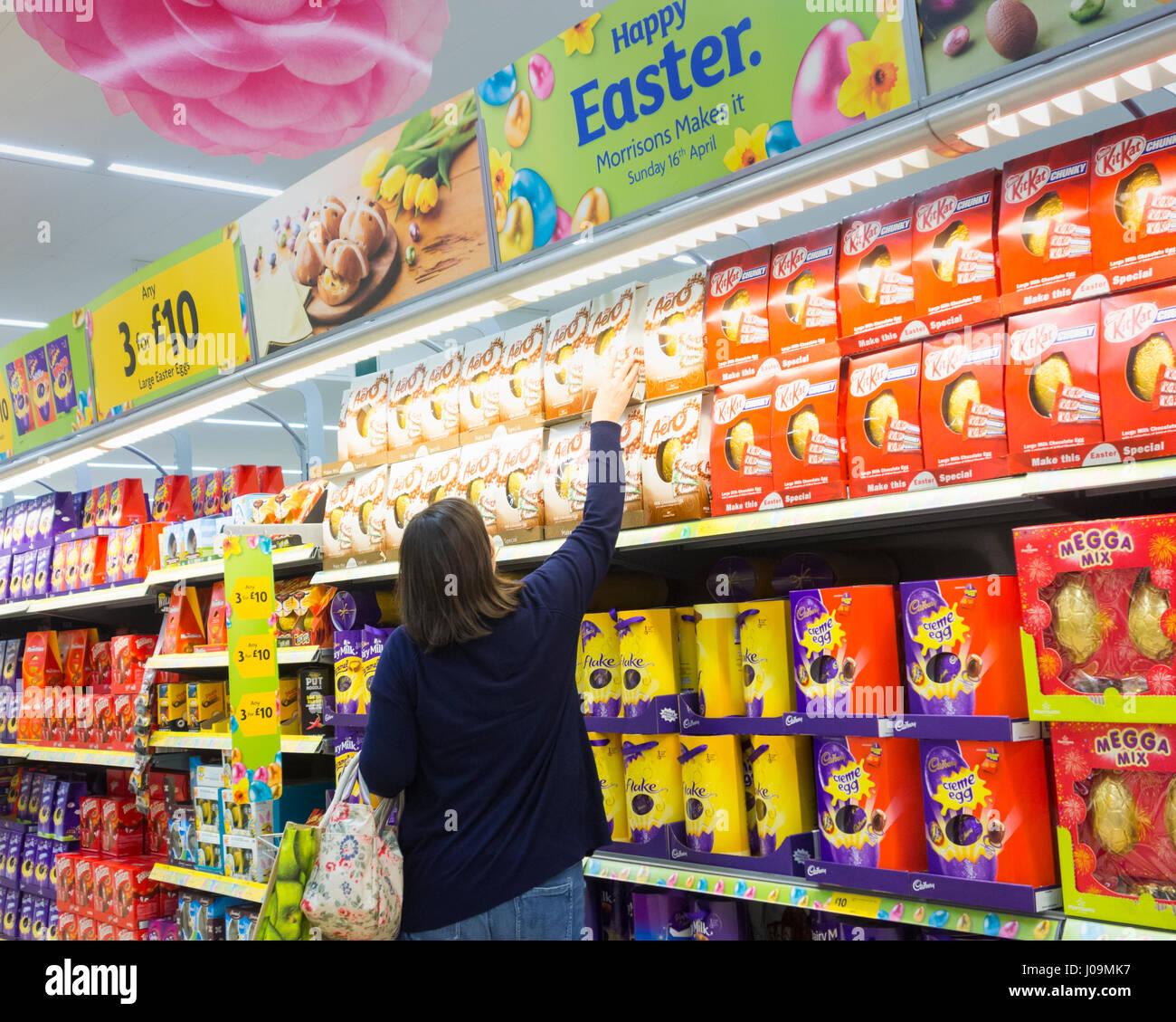 Morrisons supermarket aisle stock photos morrisons supermarket morrisons supermarket uk woman buying easter eggs stock image negle Gallery