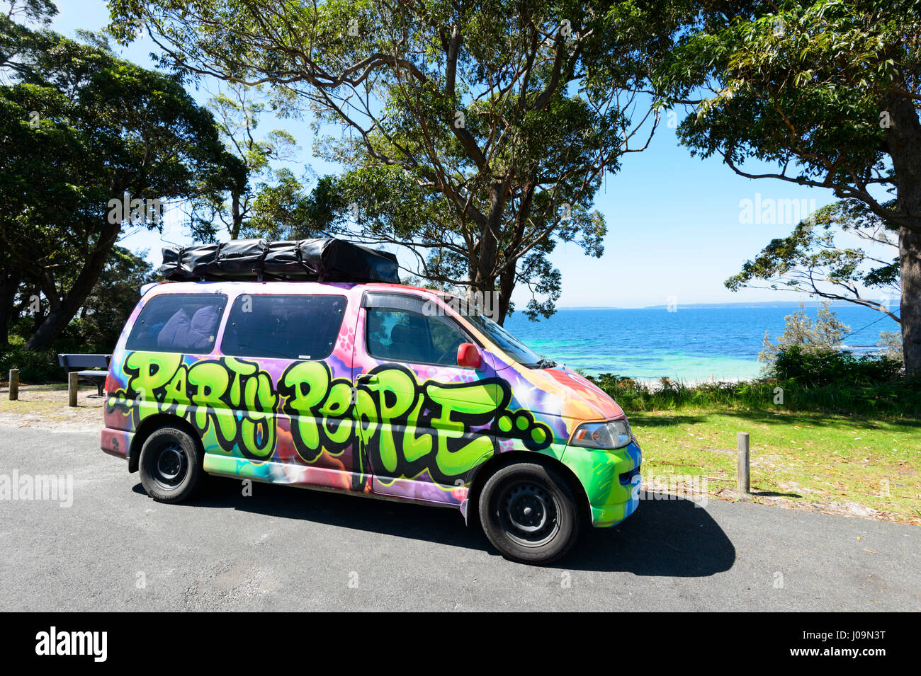 Campervan decorated with graffiti parked at Hyams Beach, Jervis Bay, South Coast, New South Wales, NSW, Australia - Stock Image