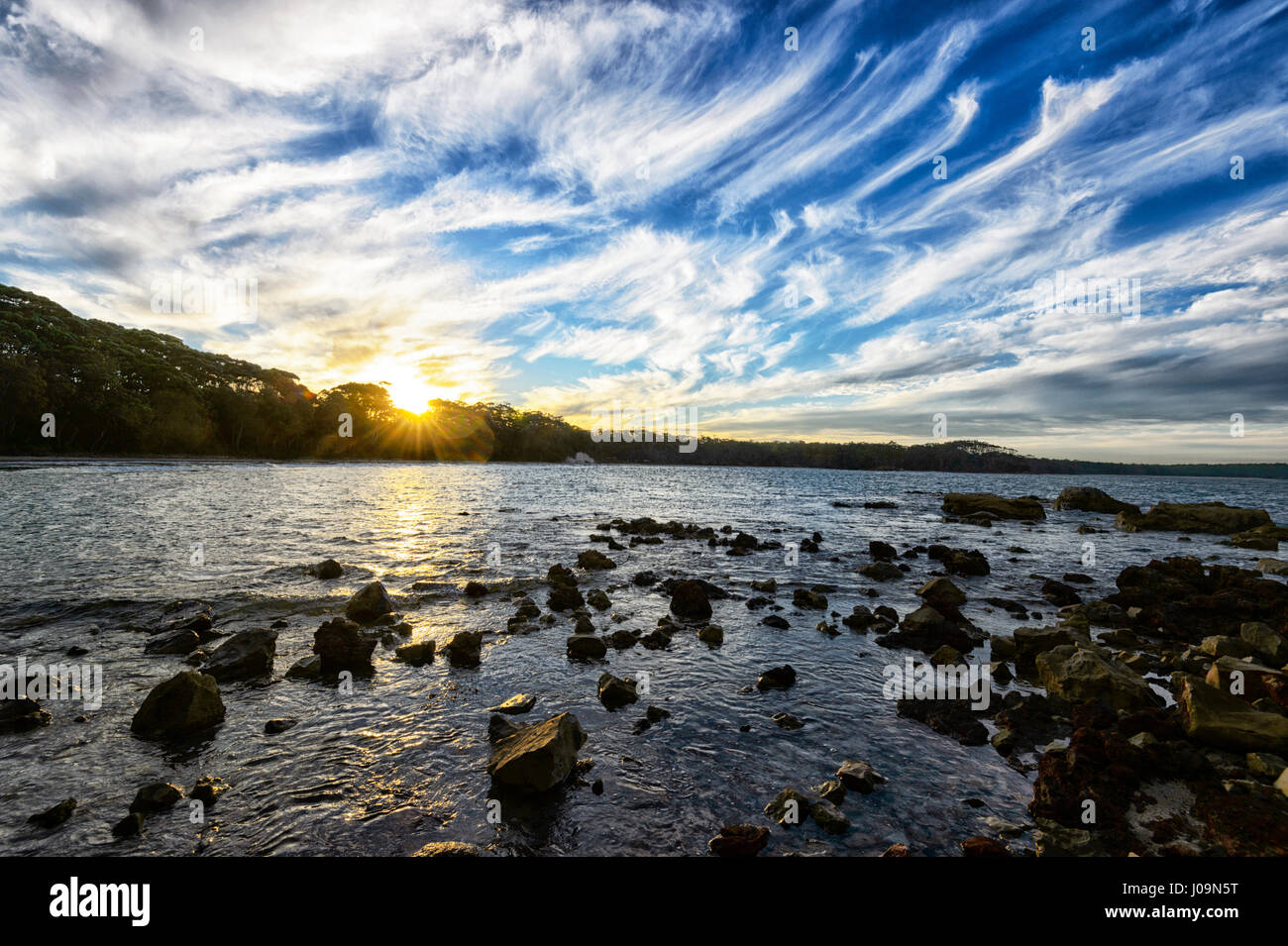 Spectacular Cloud Formations at sunset at Washerwoman's Beach, Bendalong Beach, Shoalhaven, South Coast, New - Stock Image