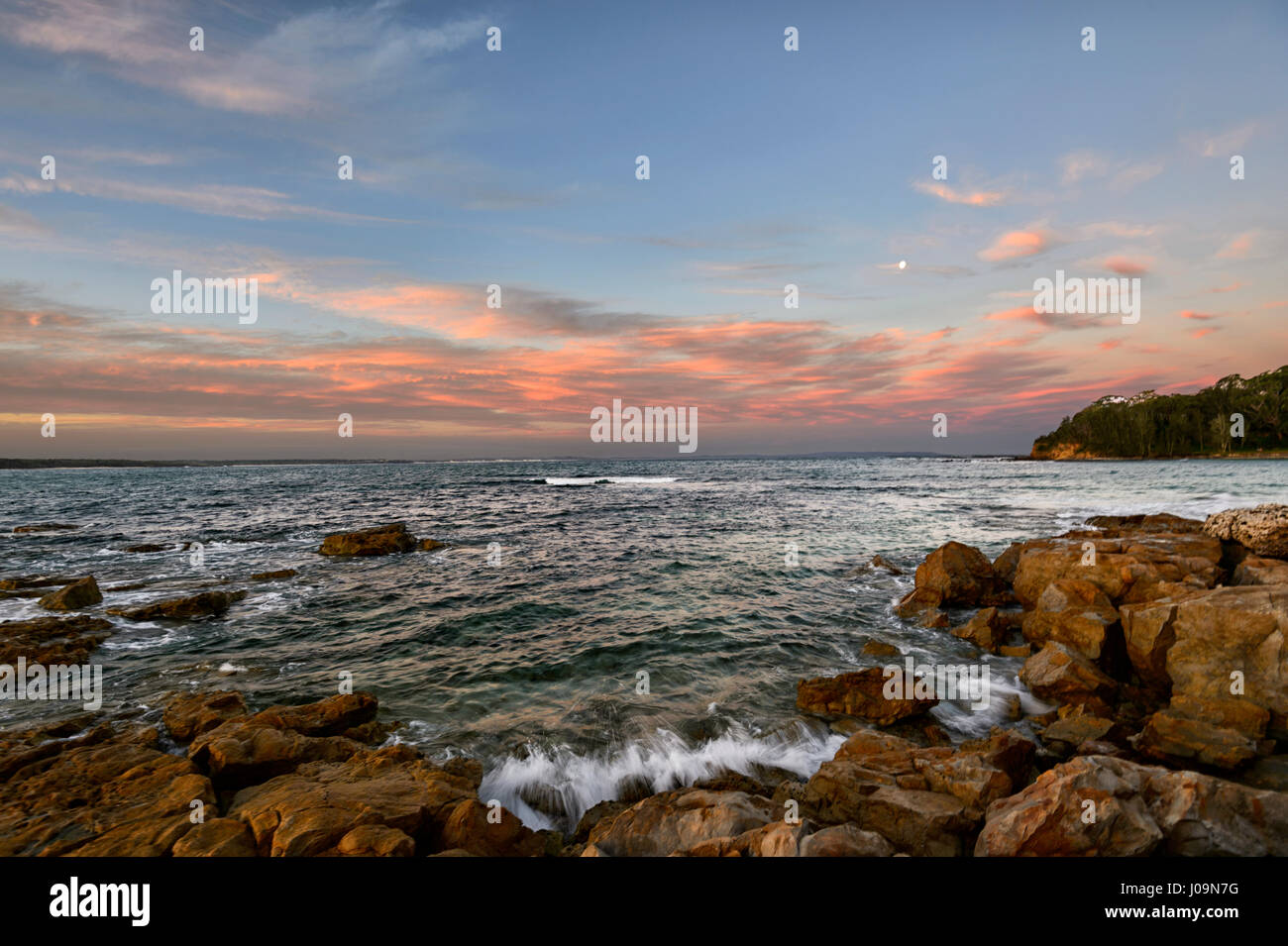 Sunset over Washerwoman's Beach, Bendalong Beach, Shoalhaven, South Coast, New South Wales, NSW, Australia - Stock Image