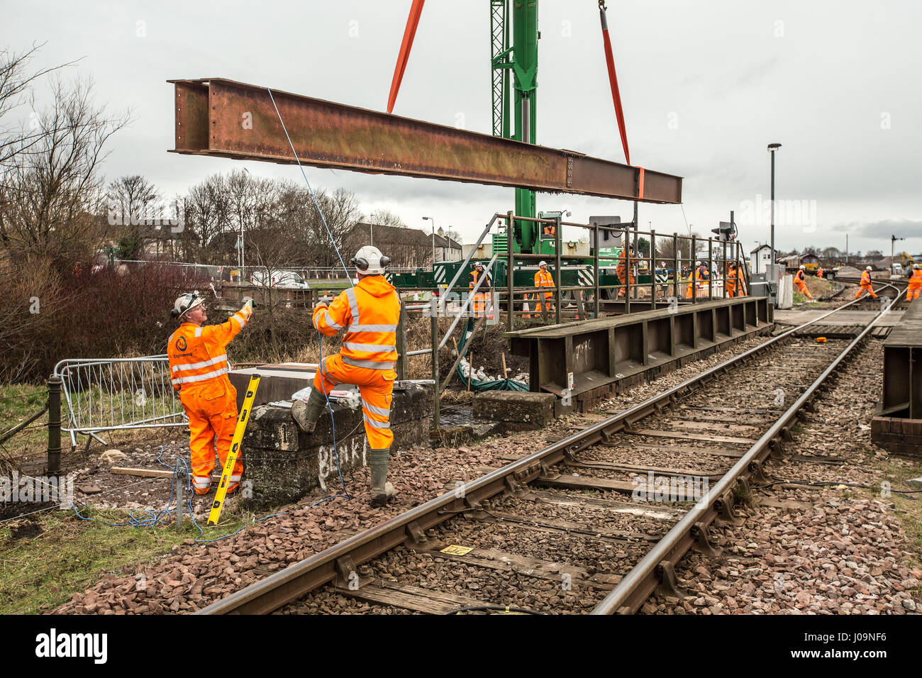 Rail construction workers installing a girder bridge - Stock Image