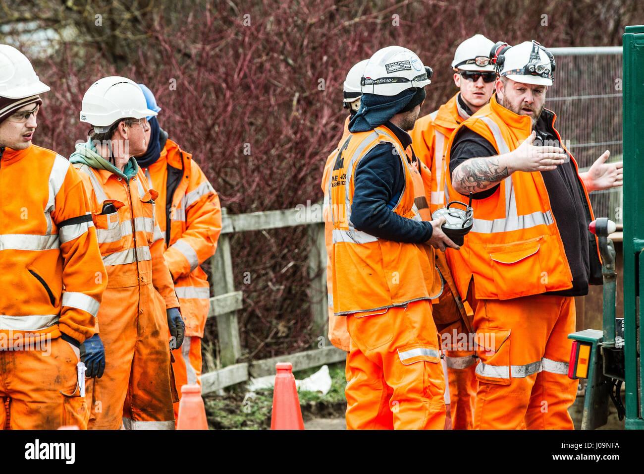 Rail construction workers installing a girder bridge Stock Photo