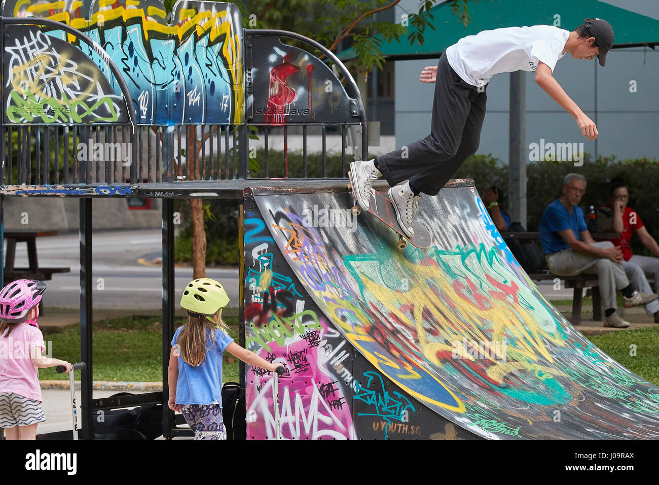 Young Asian Man Skateboarding In The SCAPE Skate Park