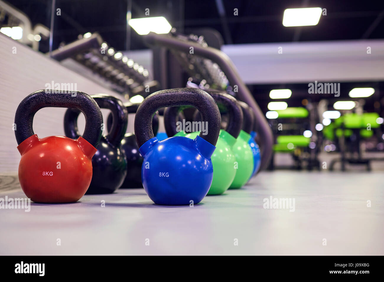Sports kettlebell  weights on  floor in the gym - Stock Image