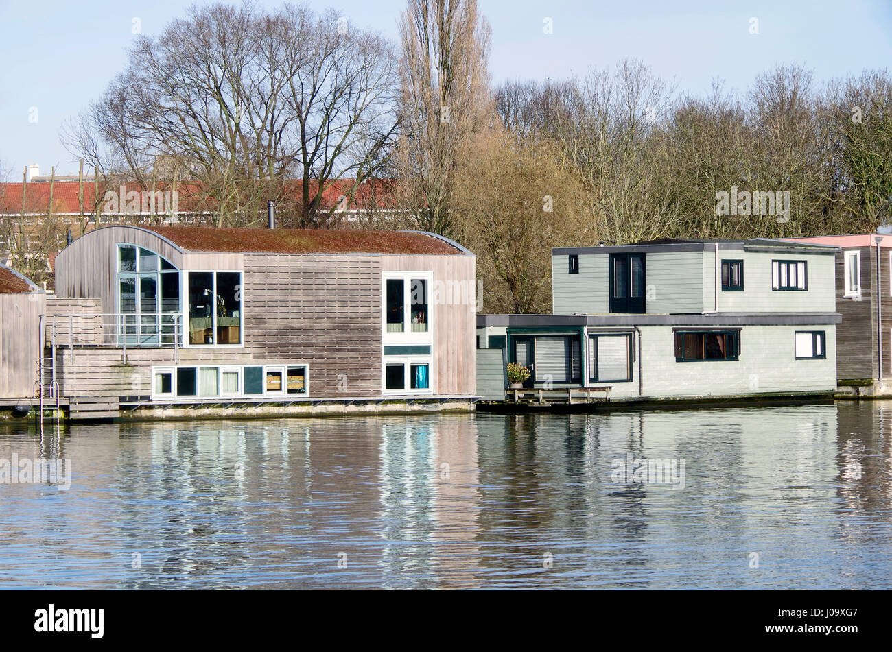 Architecturally distinguished modern house boats on Schinkel canal, Amsterdam-Zuid, Netherlands - Stock Image