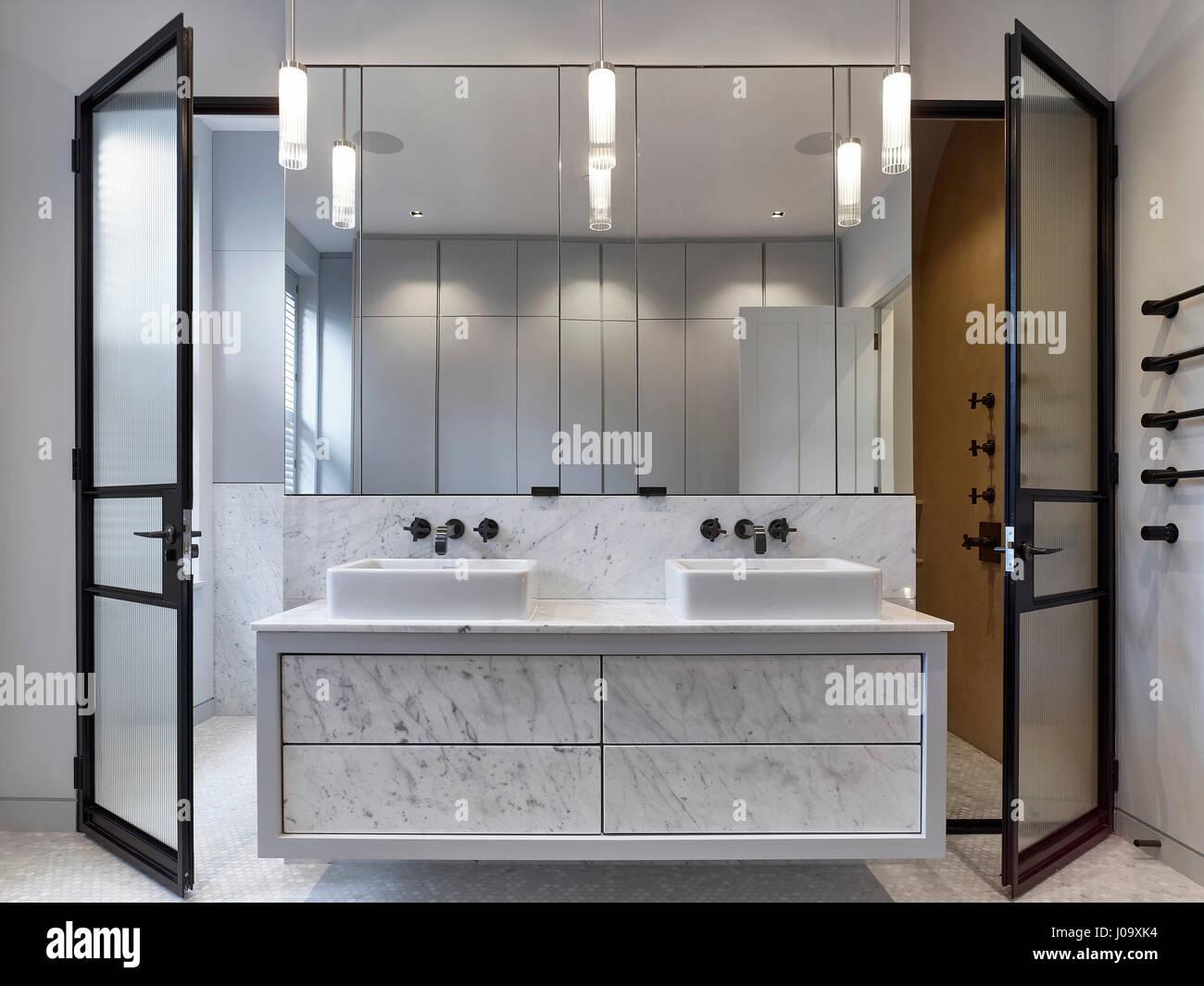 Bathroom. Hampstead Ponds House, London, United Kingdom. Architect: Stiff + Trevillion Architects, 2016. - Stock Image