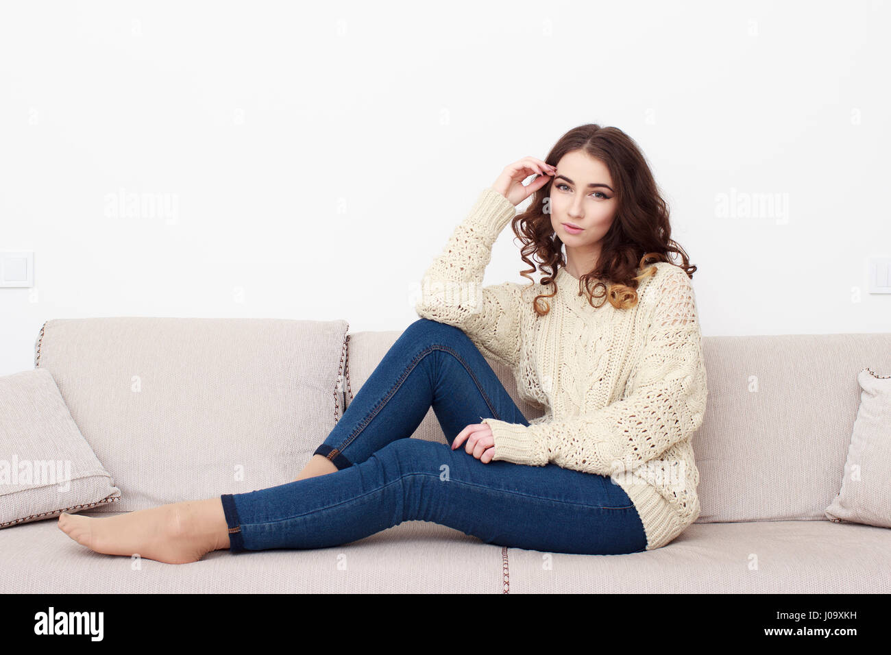 Enjoyable Girl Sit Down White Background Sofa Couch People Stock Squirreltailoven Fun Painted Chair Ideas Images Squirreltailovenorg
