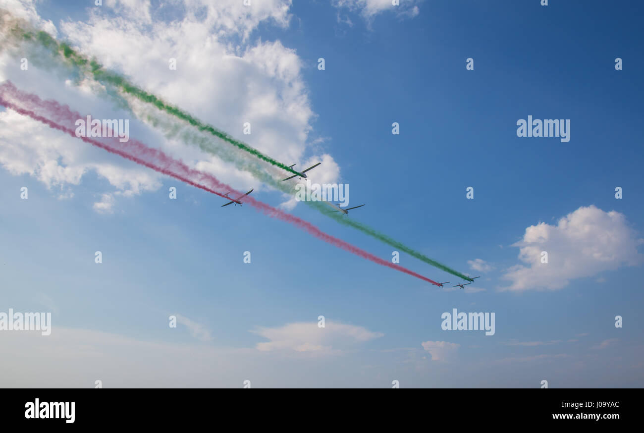 Performance ultralight aircraft with colored smoke - Stock Image