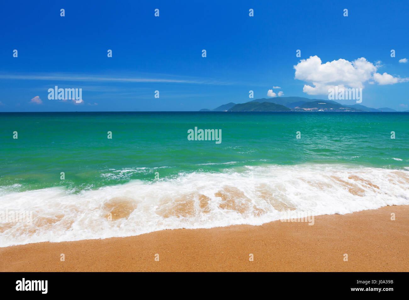 Clear blue sky over emerald South China Sea, Nha Trang, Khanh Hoa province, Vietnam - Stock Image