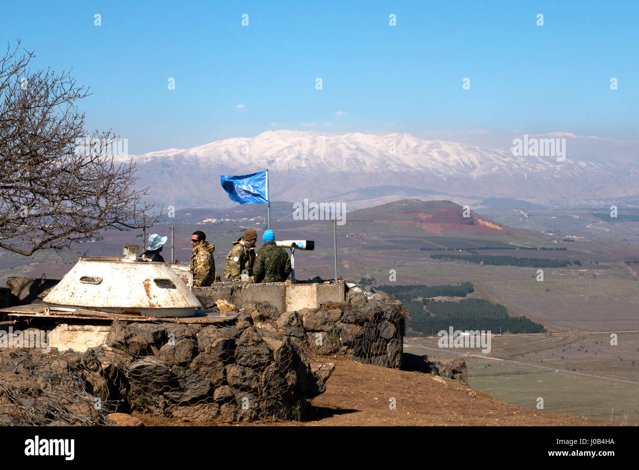 U.N peace keeping soldiers observing the Israel - Syria  border from the Israeli side. - Stock Image