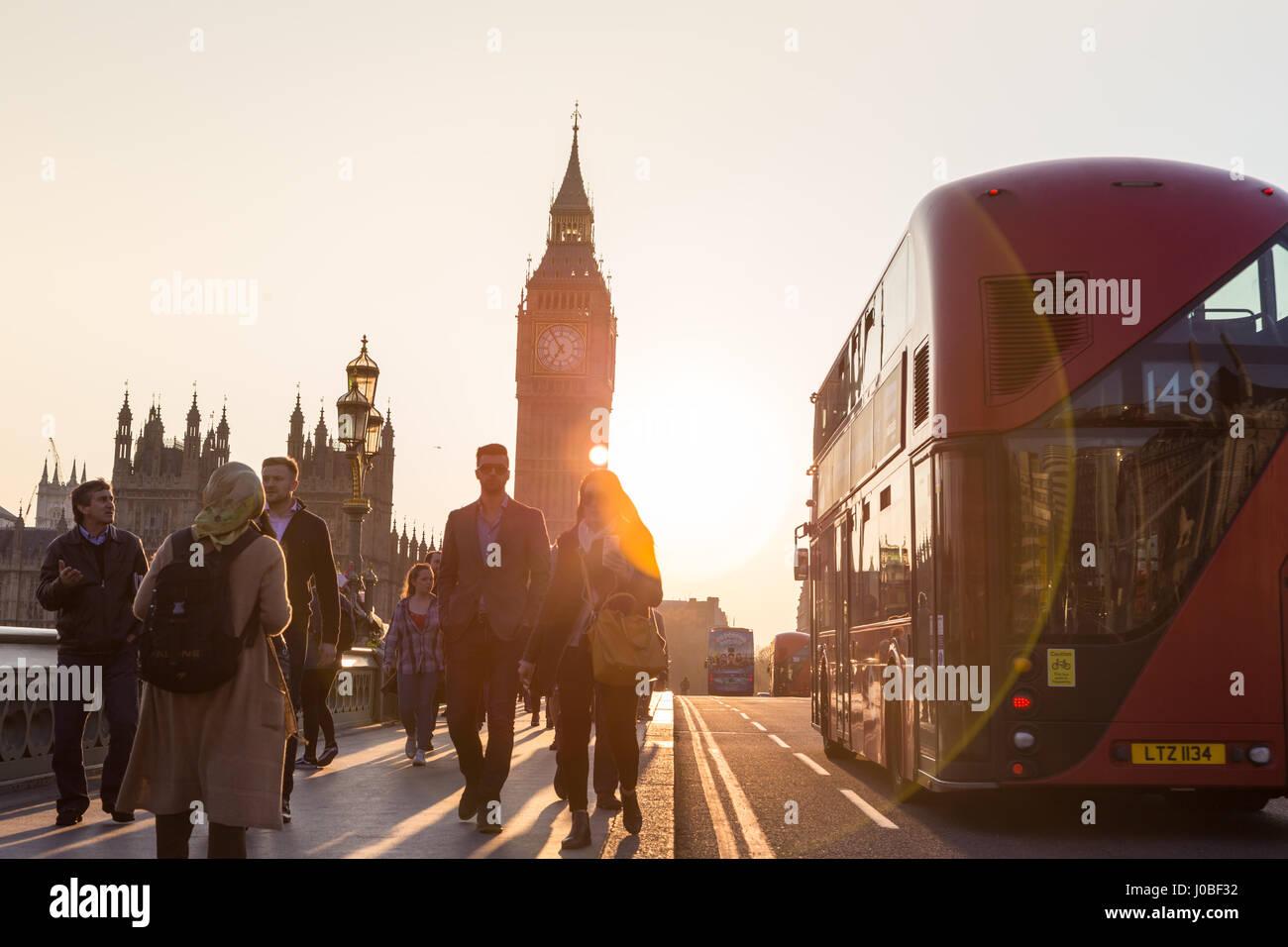 Traffic and random people on Westminster Bridge in sunset, London, UK. - Stock Image