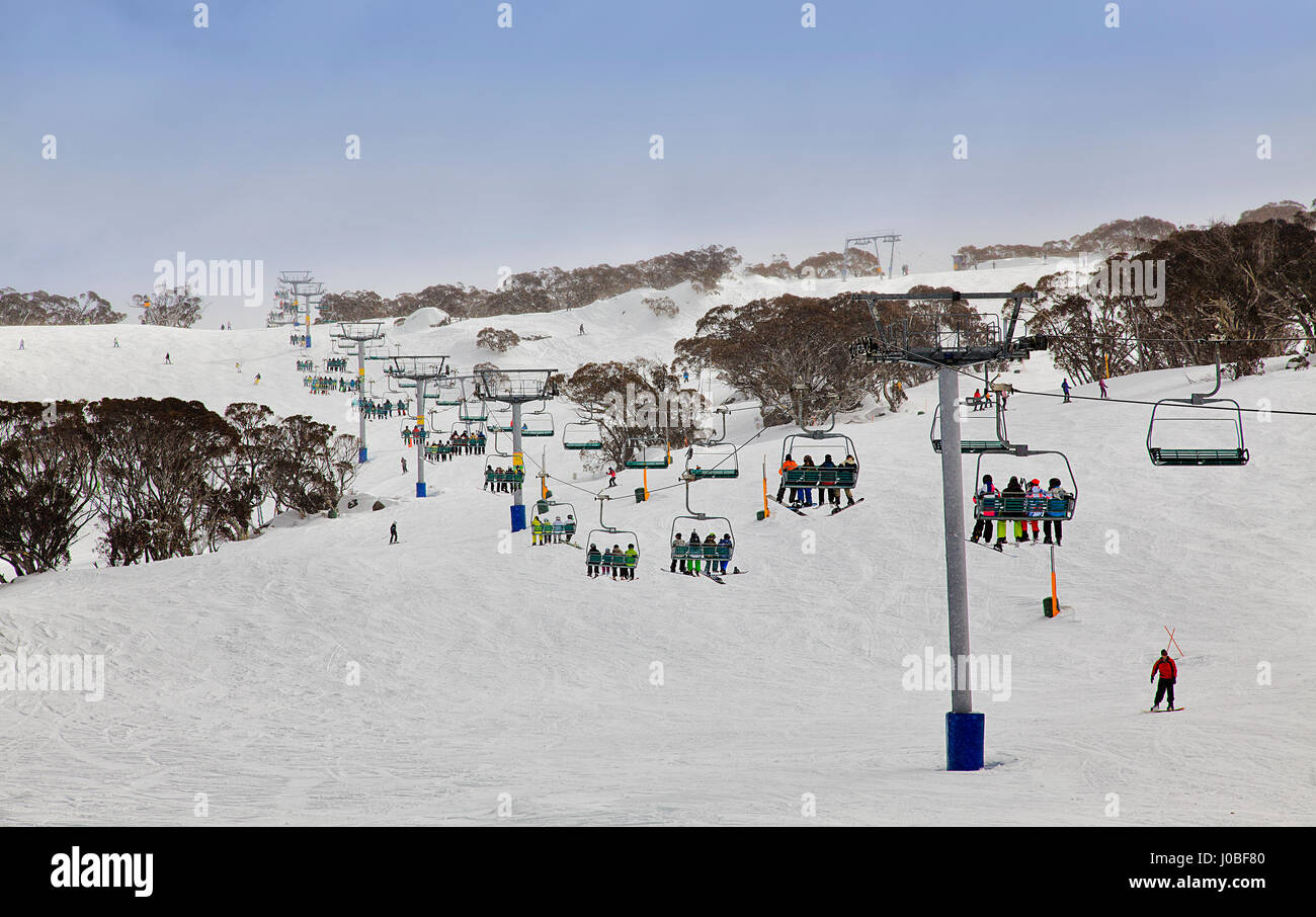 Skiing resort of Australia - Snowy mountains. Perisher valley cableway transports skiers to mountain tops between - Stock Image