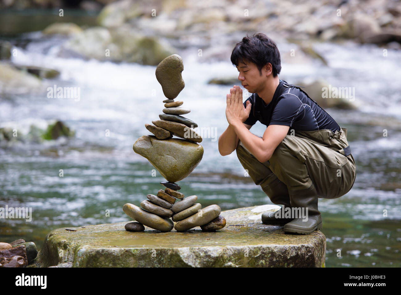 YASUKAWA VALLEY, JAPAN: INCREDIBLE pictures and video have captured the gravity-defying feats of one man who calls - Stock Image