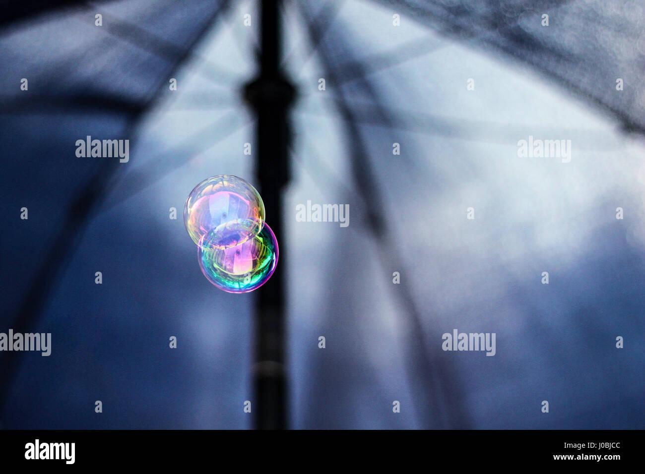 Two bubbles under umbrella - Stock Image