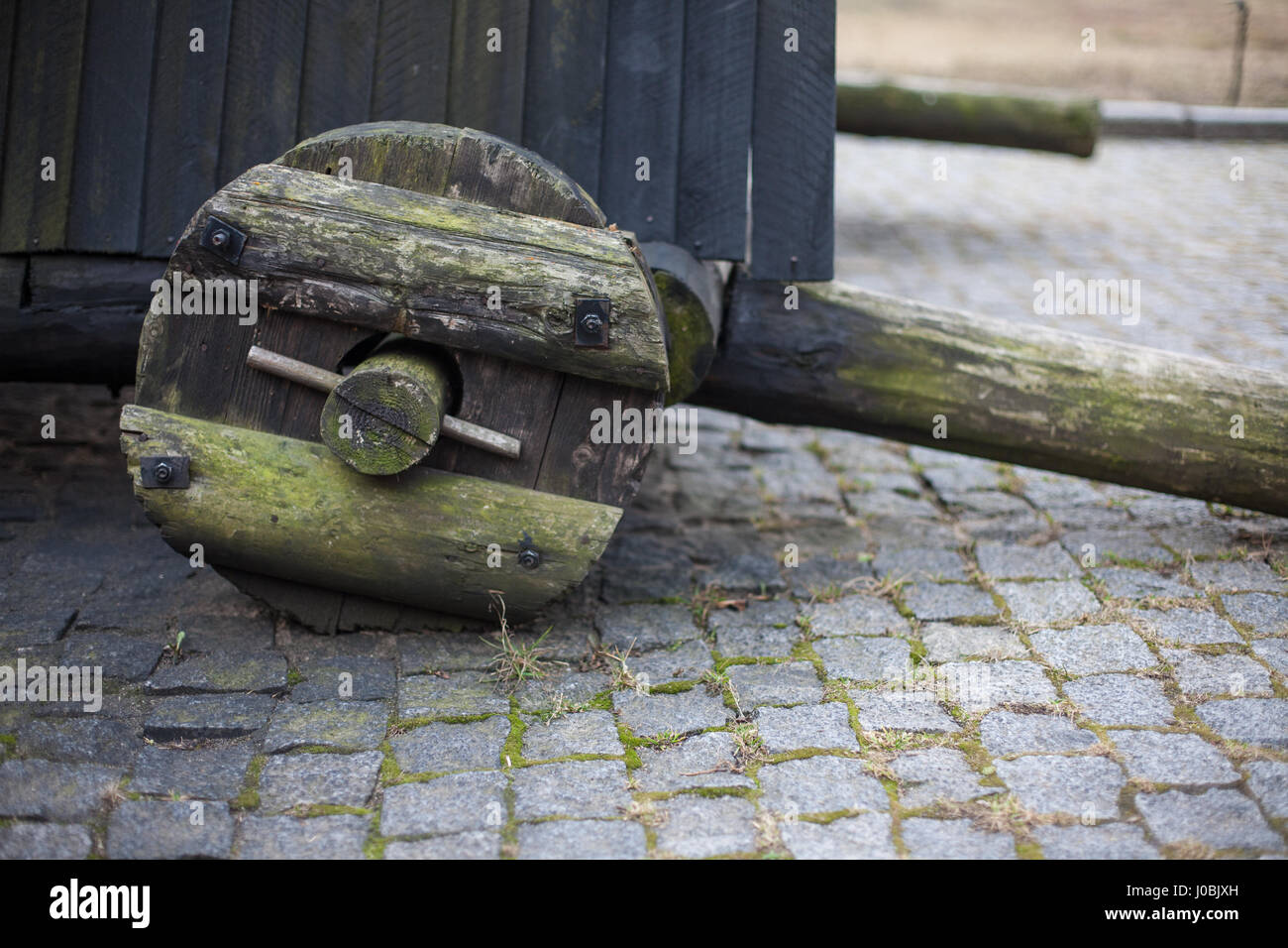 Military wooden props with wheels in the old castle - Stock Image