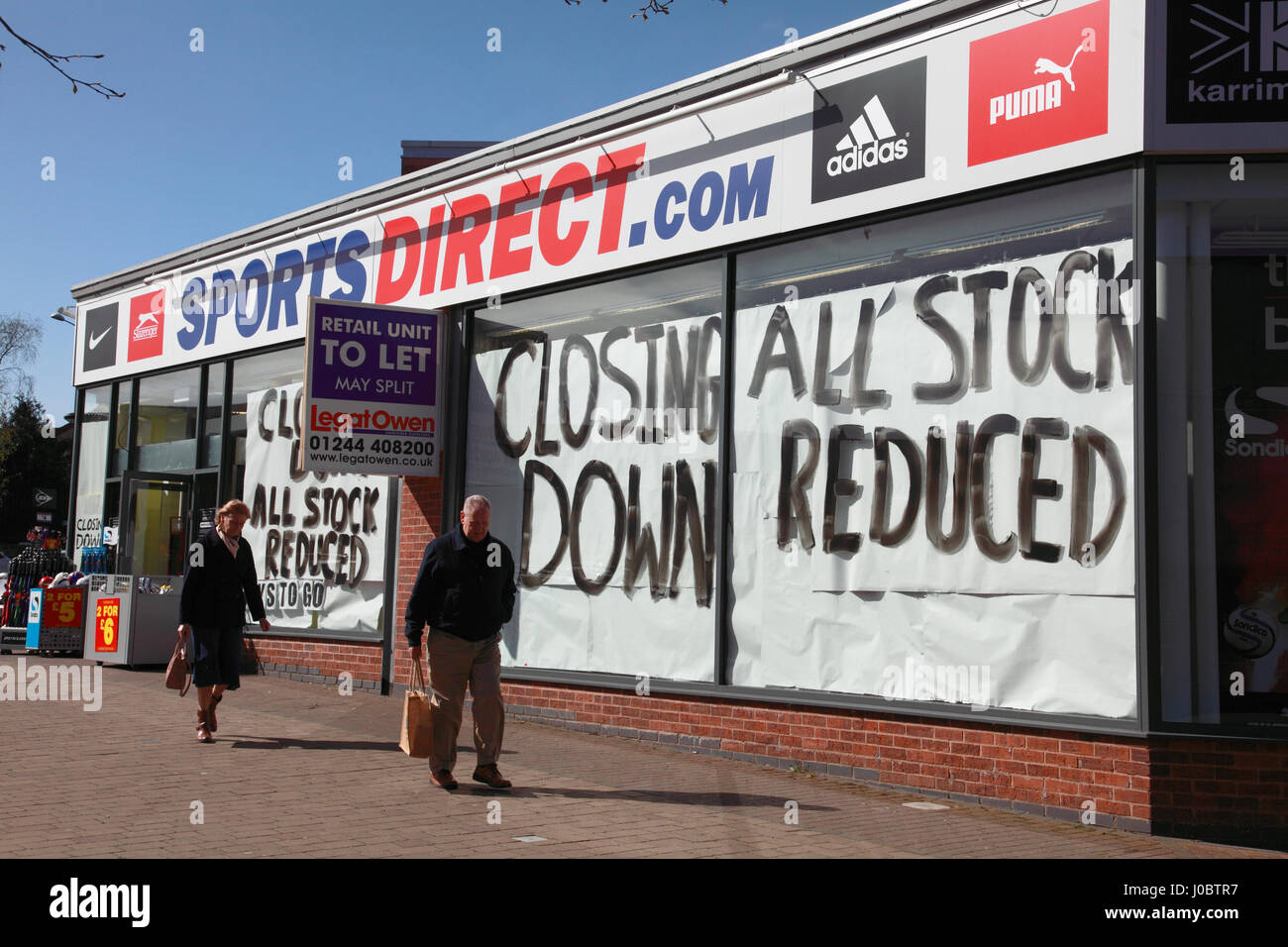 The branch of Sports Direct in the market town of Market Drayton, Shropshire, with signs showing it is about to - Stock Image