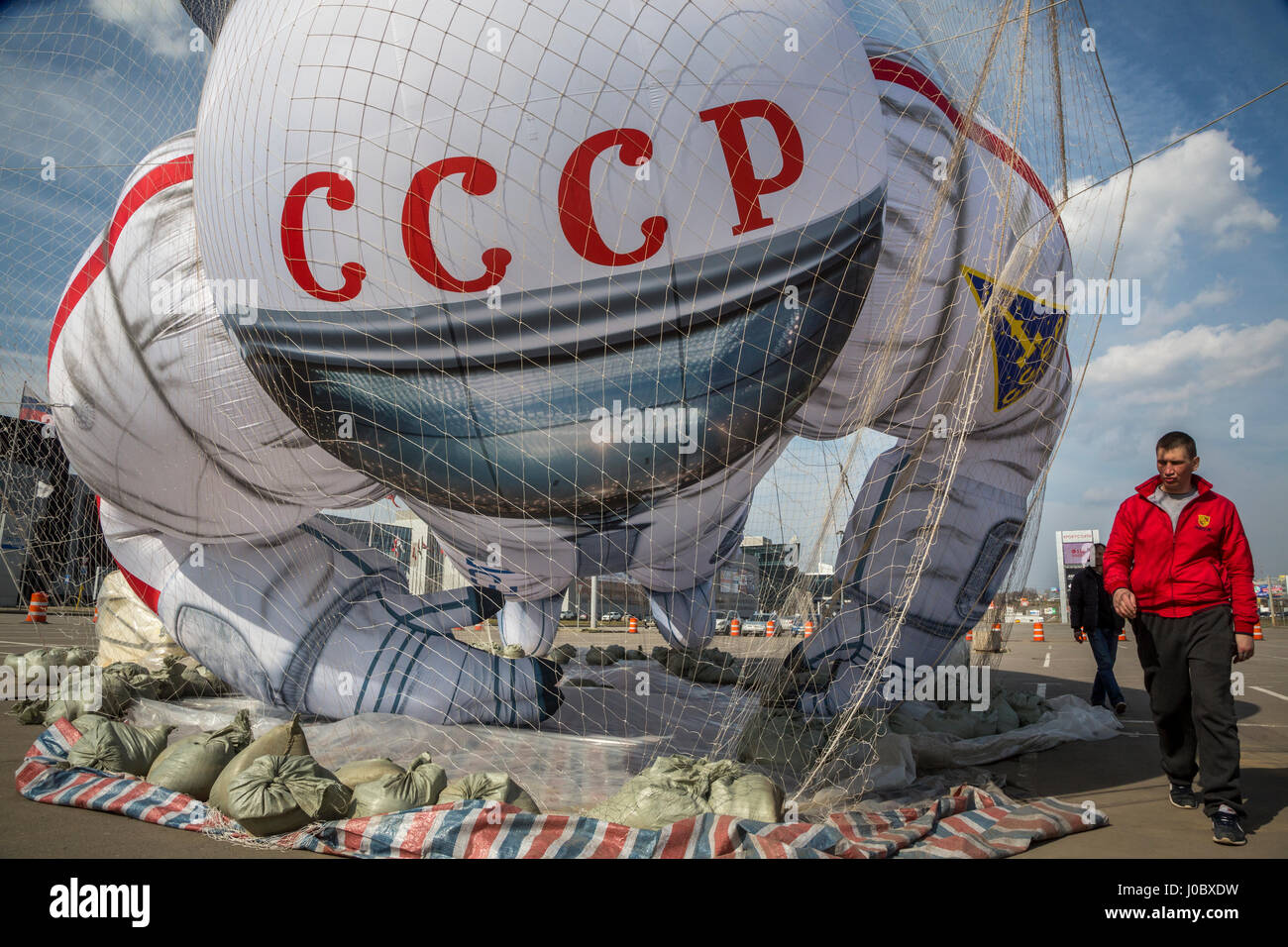 A balloon in the form of a Soviet cosmonaut at a shopping center in Moscow, Russia - Stock Image
