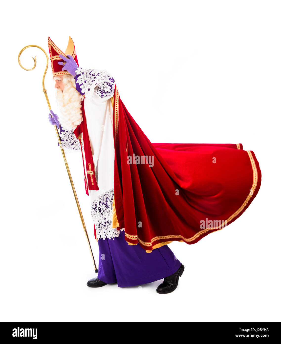 159fb5f2e05db Sinterklaas holding hat in windy weather. isolated on white background.  Dutch character of Santa Claus