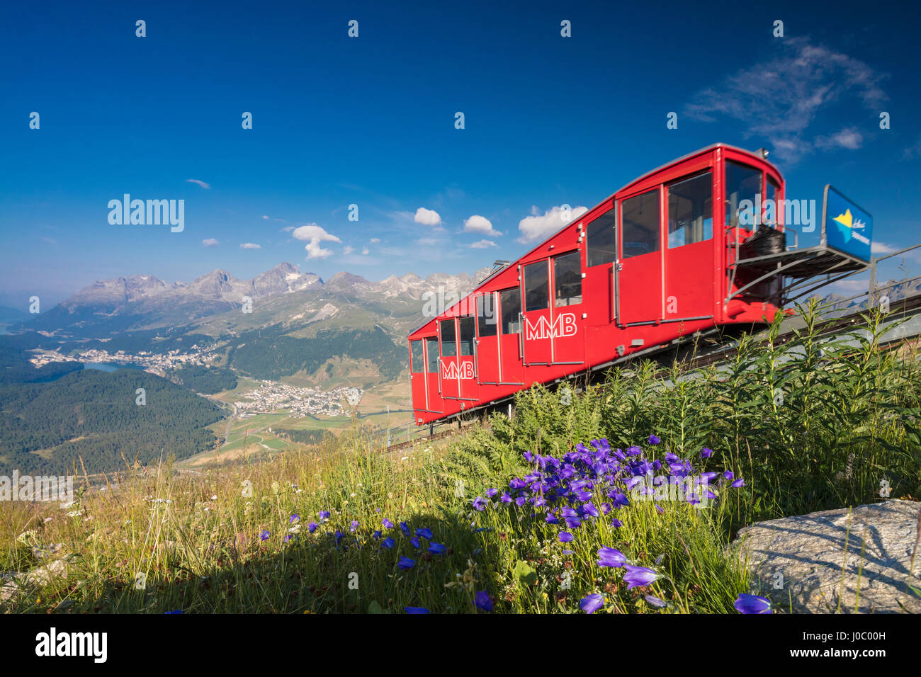 The funicular railway runs across the alpine meadows, Muottas Muragl, Samedan, Canton of Graubunden, Engadine, Switzerland - Stock Image