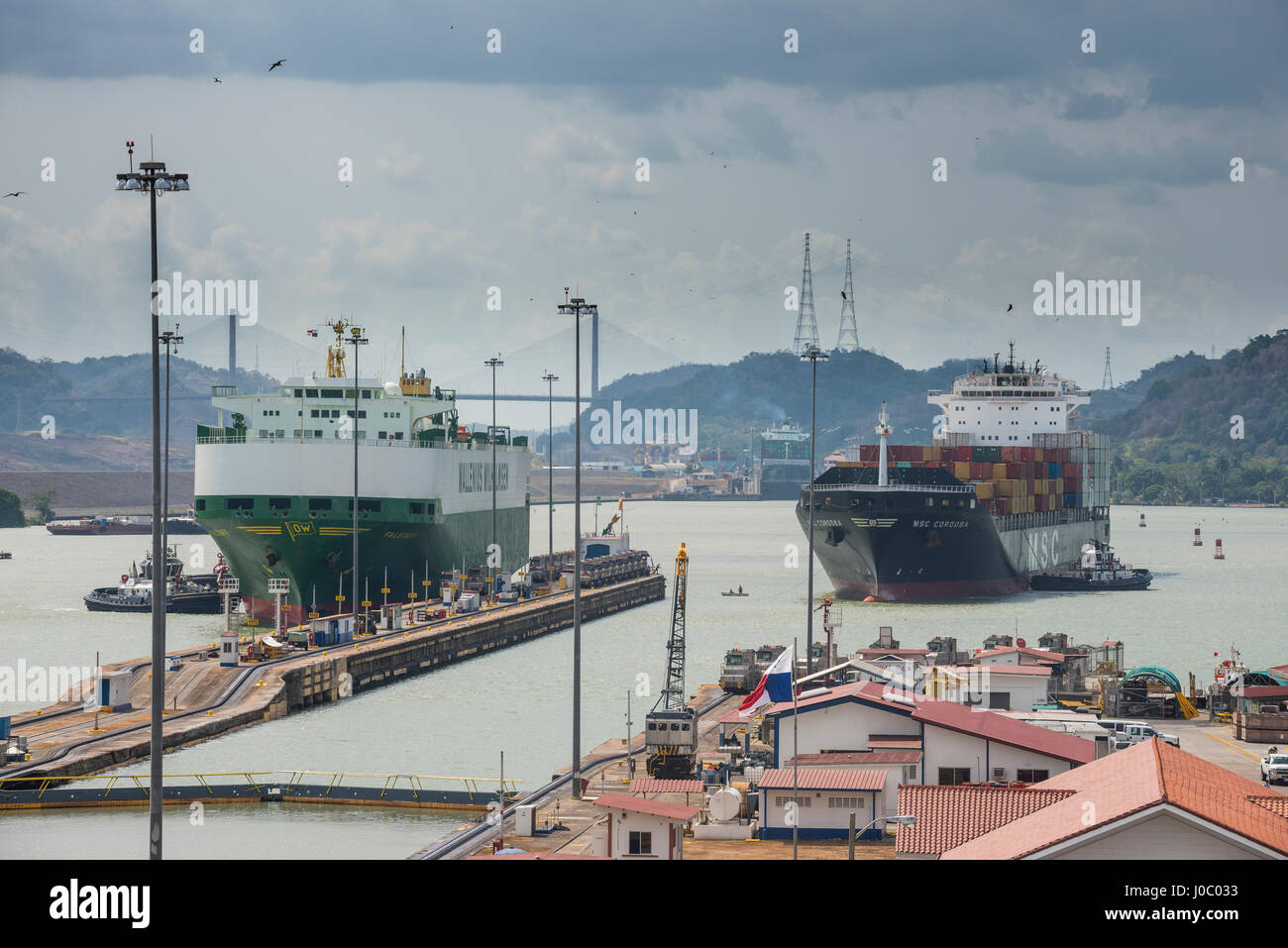 Cargo boats passing the Miraflores Locks, Panama Canal, Panama City, Panama, Central America - Stock Image