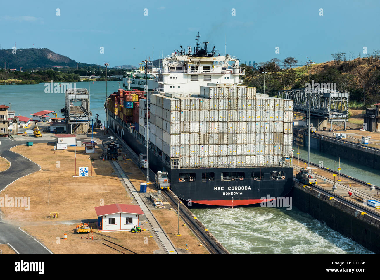 Cargo boat passing the Miraflores Locks, Panama Canal, Panama City, Panama, Central America - Stock Image