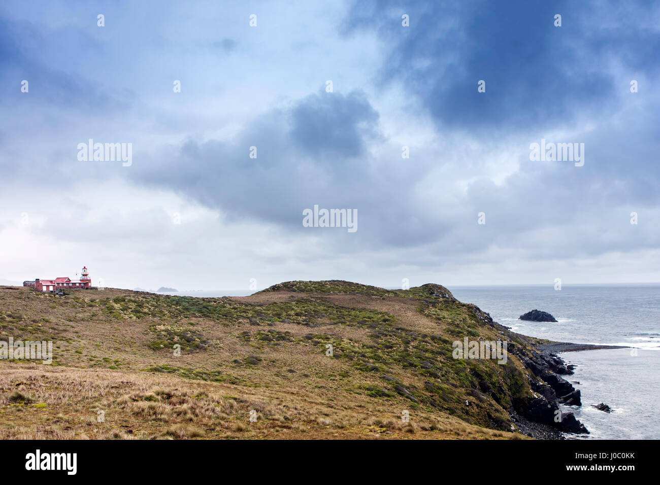 The lighthouse at Cape Horn at the far southern end of South America, islands of Cape Horn National Park, Patagonia, - Stock Image