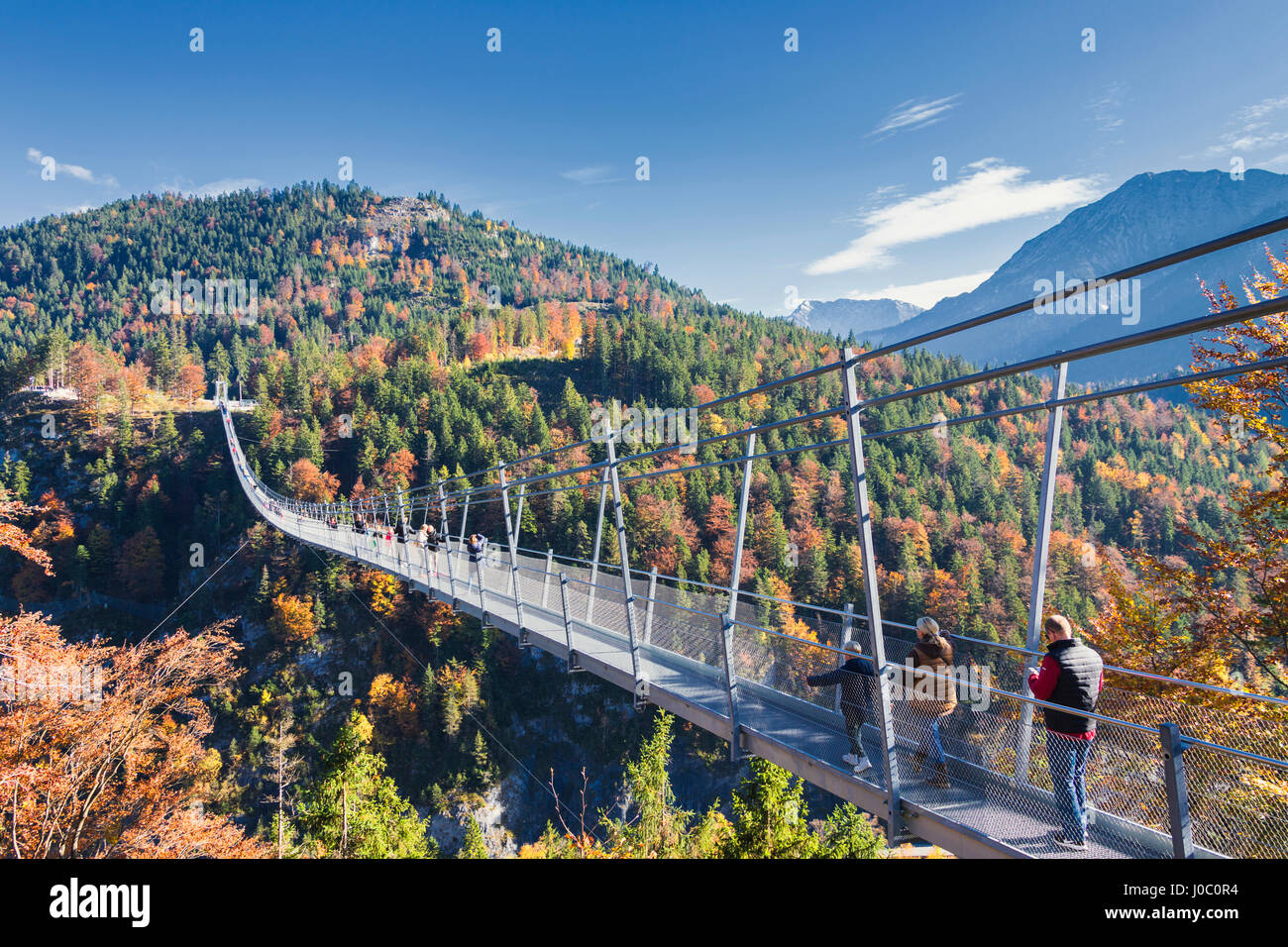 Tourists on the suspension bridge called Highline 20 framed by ...